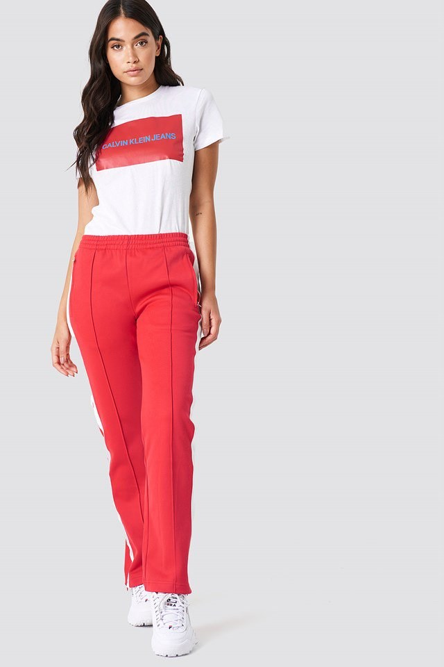 Red Trousers with a White Top
