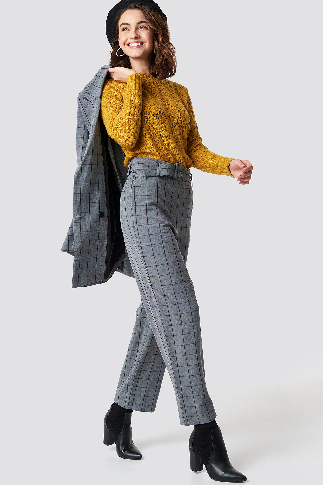 The Mokita Pants by Gestuz features a high waist, straight fit, side slanting pockets, mock back pockets, belt loops, waist belt with a buckle and eyelets, and a side zip and button closure.