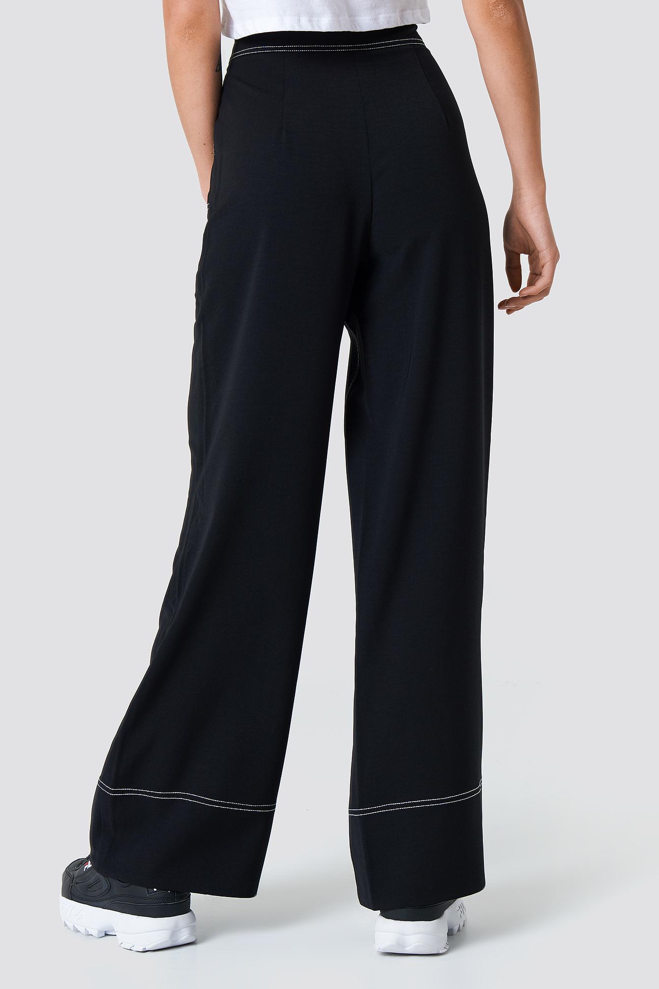 Szerokie spodnie z kontrastowymi szwami NA-KD.COM
