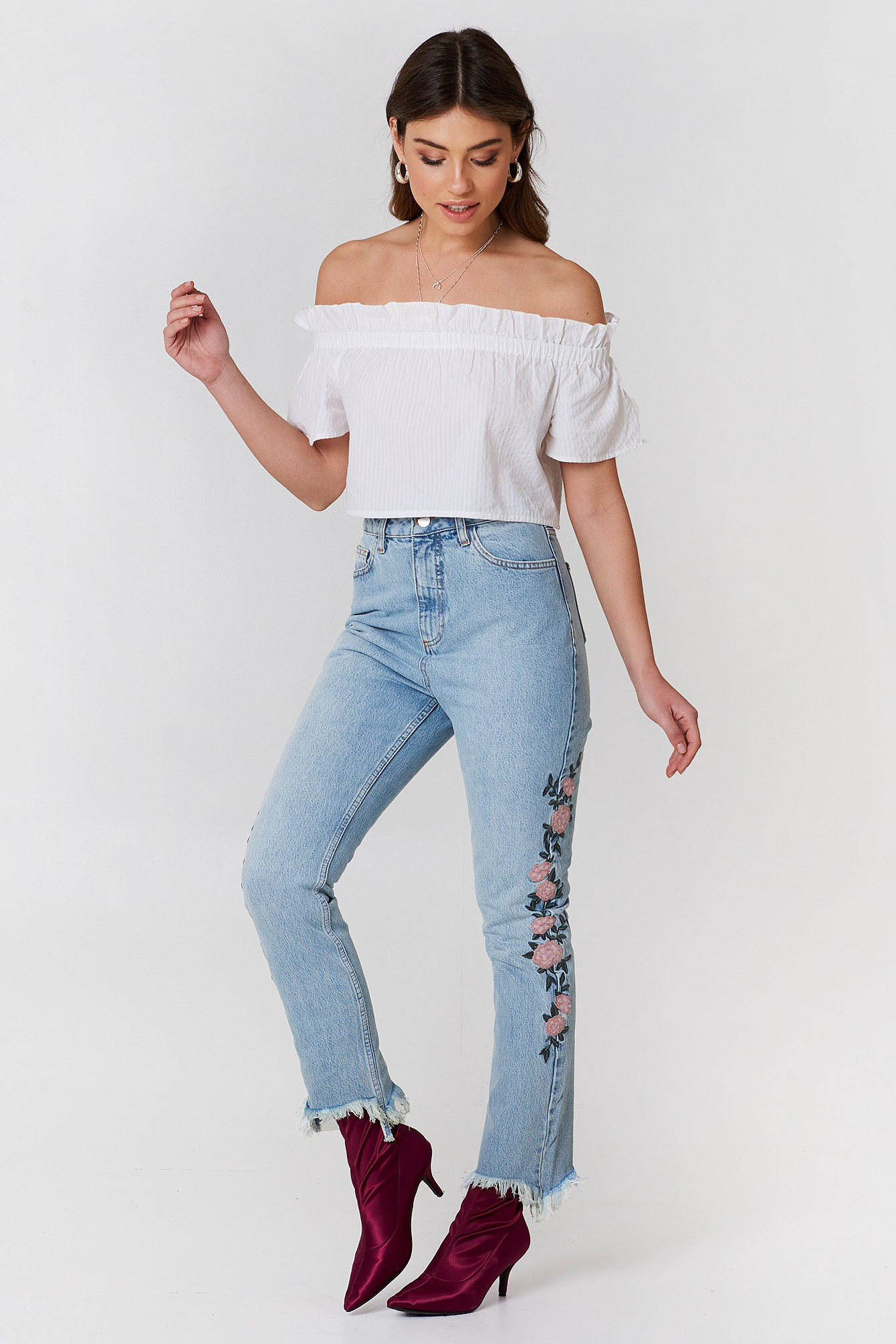 Embroidered Ripped Bottom Jeans NA-KD.COM