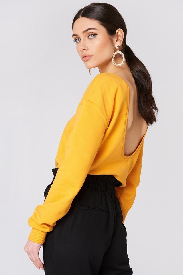 Sweter z głębokim dekoltem z tyłu Orange