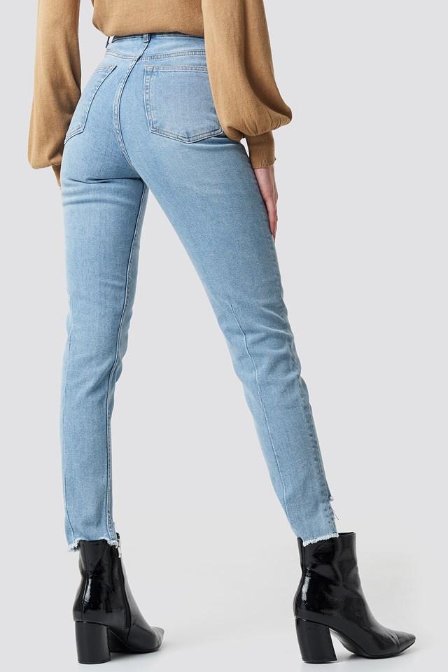 High Rise Slim Asymmetric Hem Jeans Light Blue