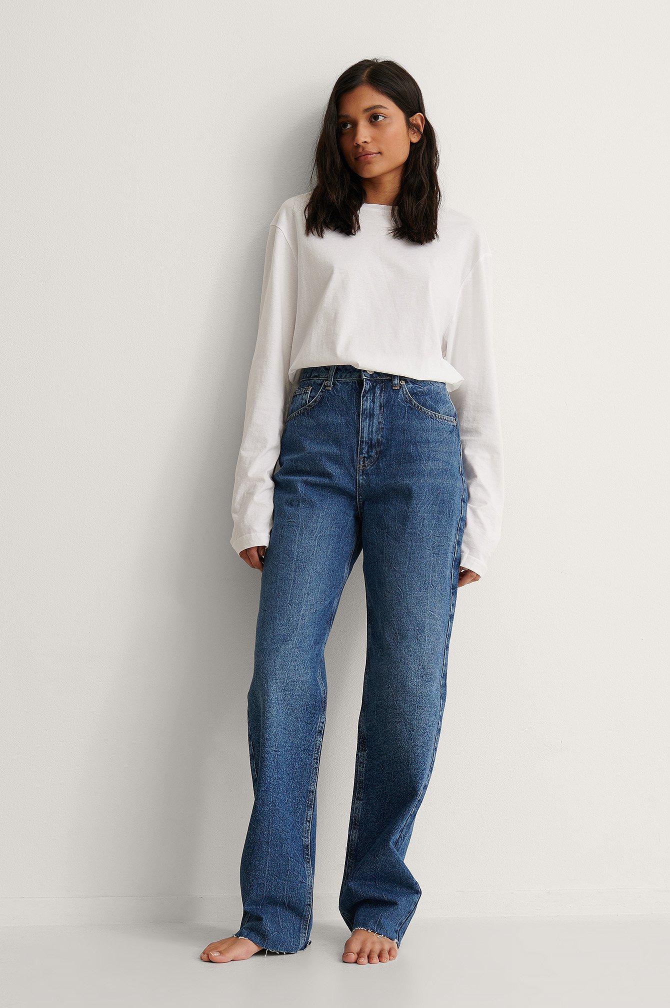 NA-KD Trend Økologiske jeans med en høj talje, vide ben og en rå søm - Blue