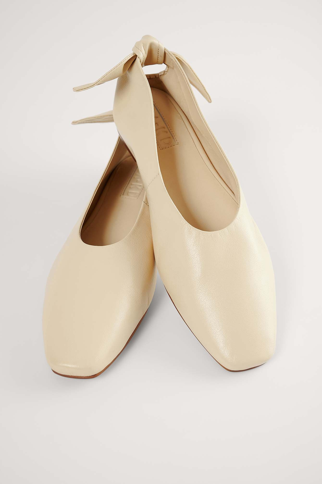 Beige Leather Bow Ballerinas