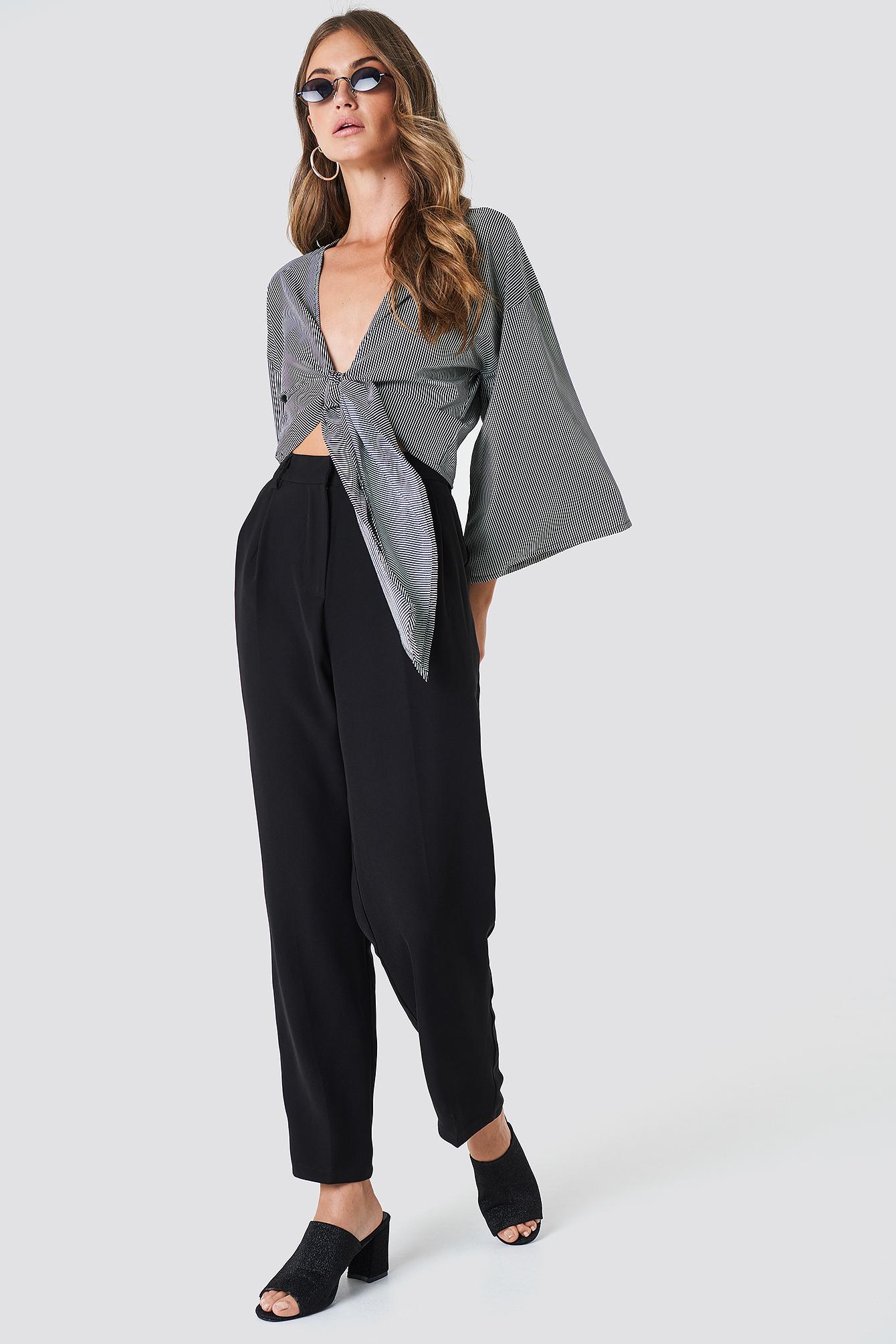 Luźne spodnie garniturowe NA-KD.COM