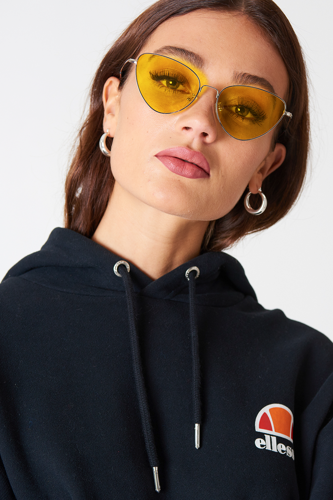 The Metal Frame Cat Eye Sunglasses by NA-KD Accessories features thin metal temples with dark tipped edges, cat eye frames, clear colored lenses, and a small nose bridge.