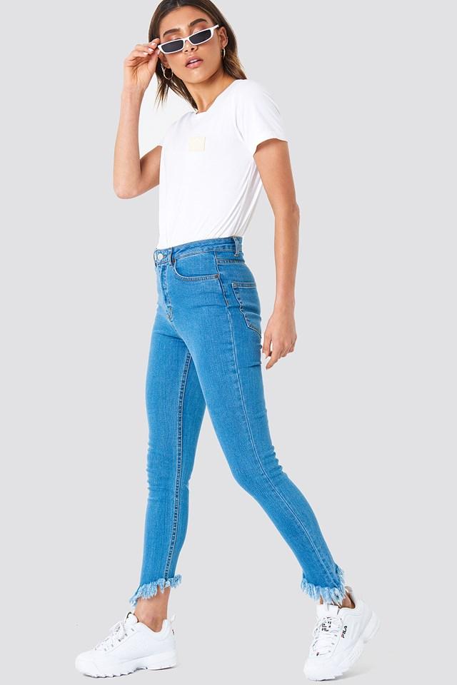 Slanting Hem Jeans Mid Blue