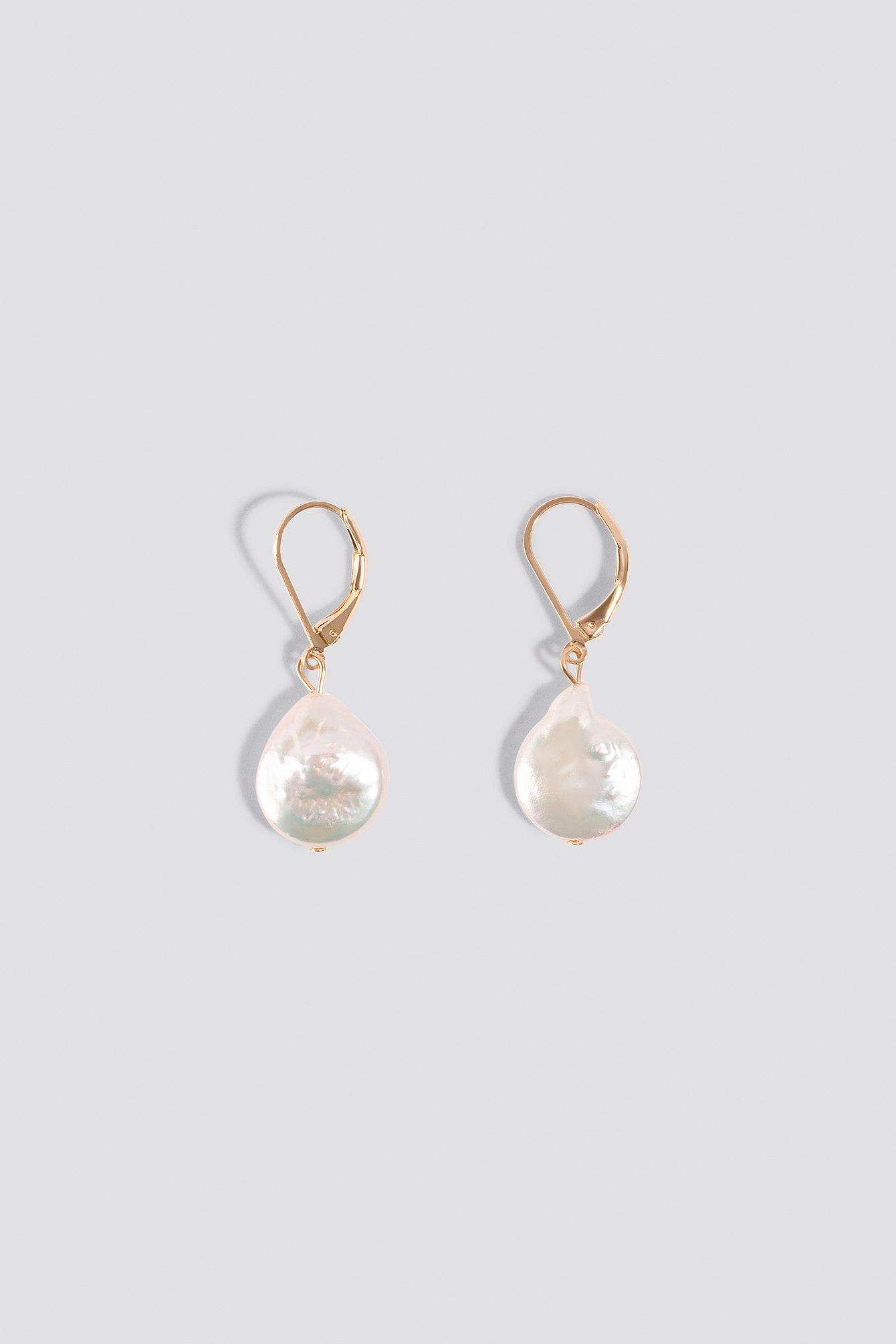 Uneven Rounded Fresh Water Pearl Earrings NA-KD.COM