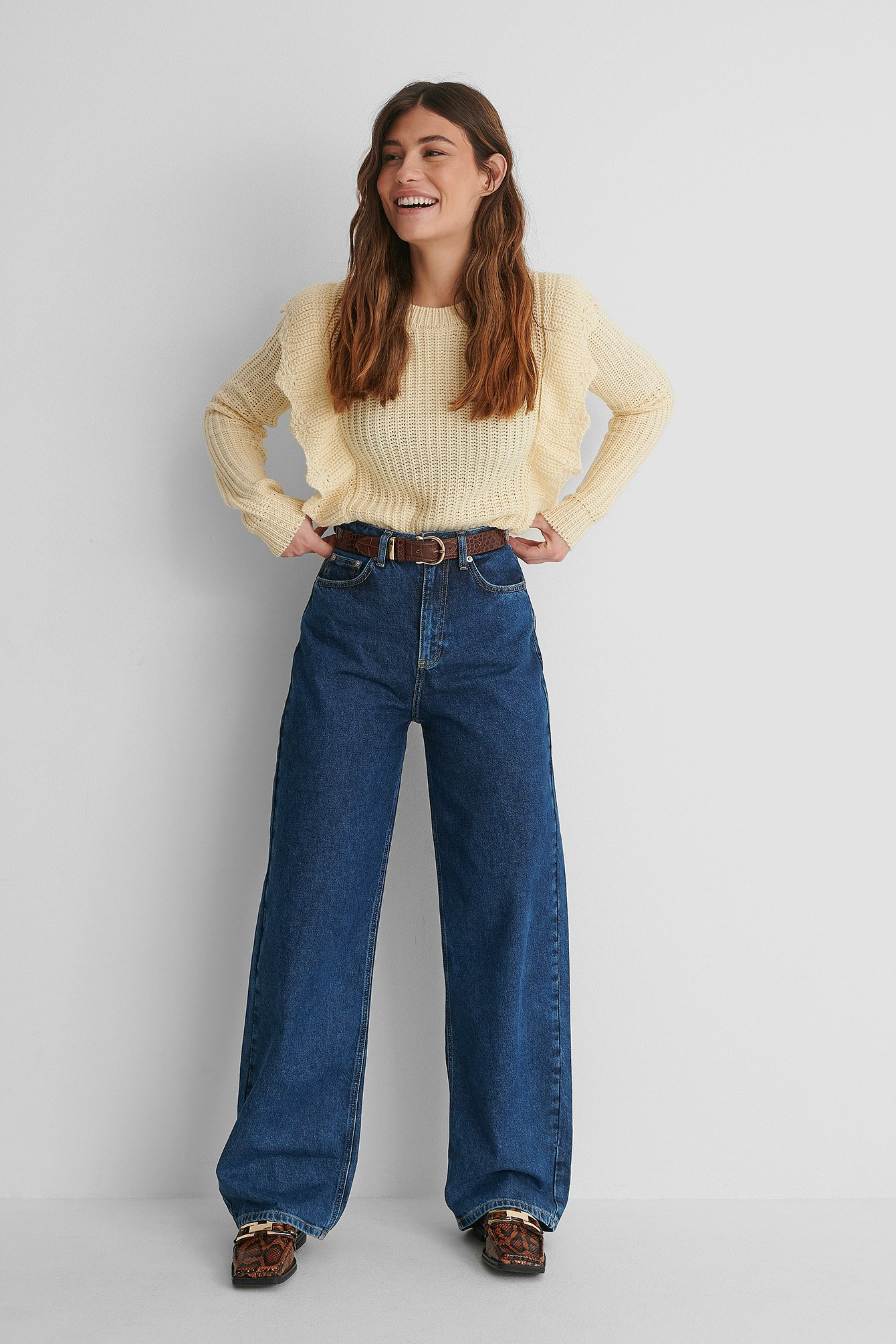Flounce Detail Long Sleeve Knitted Sweater with Wide Jeans.