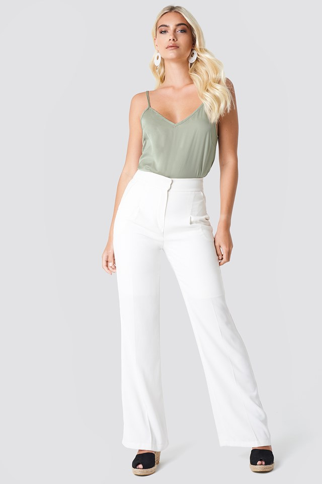 Singlet on White Trousers