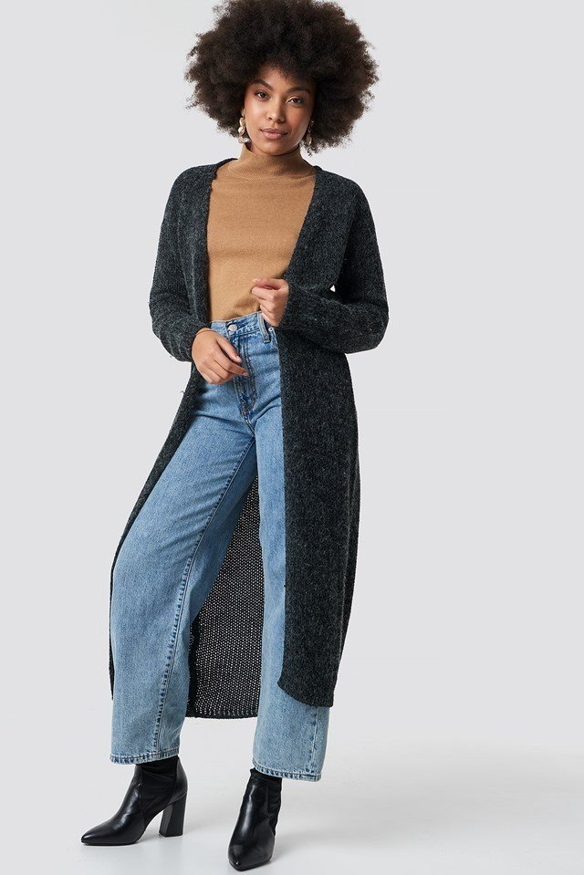 Long Knitted Cardigan with Camel Polo Top, Wide-Legged Jeans and Black Boots.