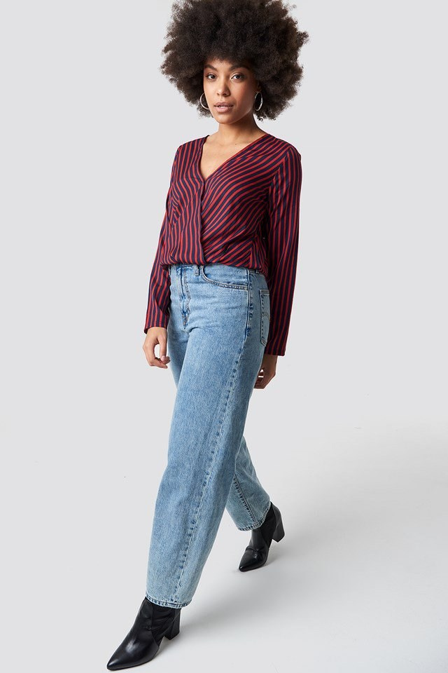Striped Blouse with Wide Jeans and Black Boots.