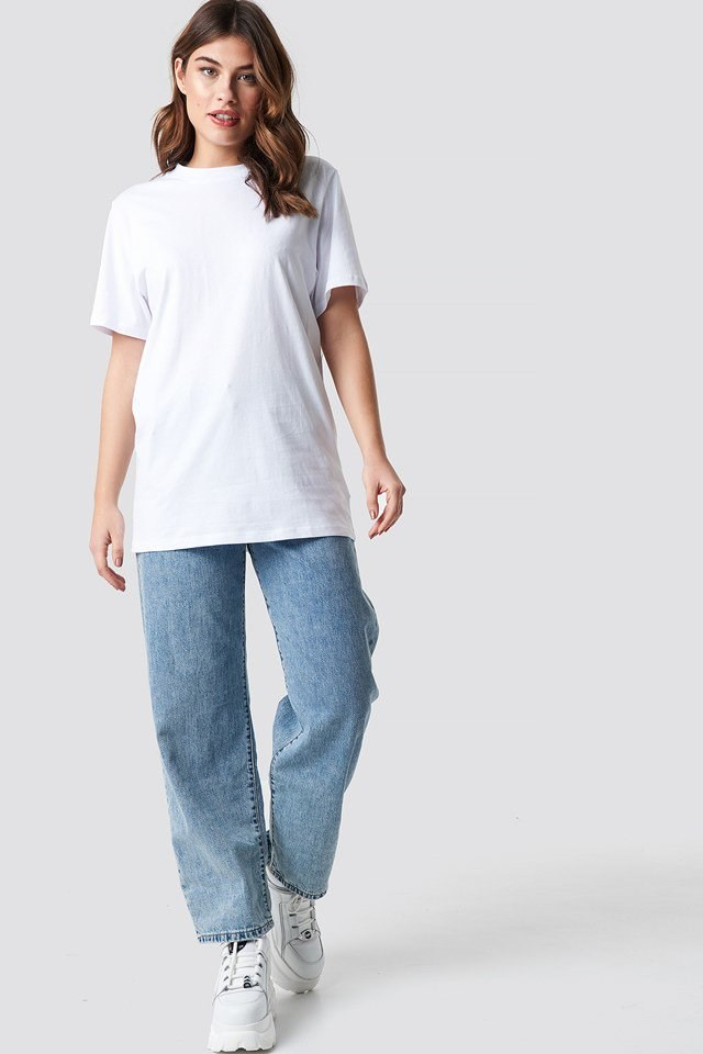 White Unisex Tee with Wide Jeans and Chunky Sneakers.