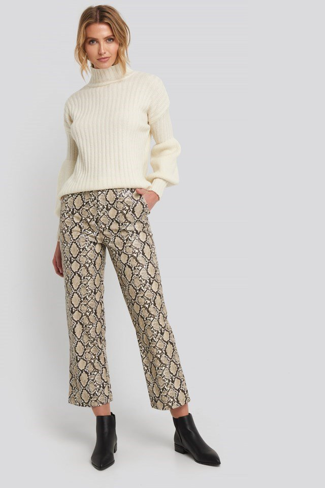 Style this sweater with straight pants, ankle boots and gold-colored hoops.