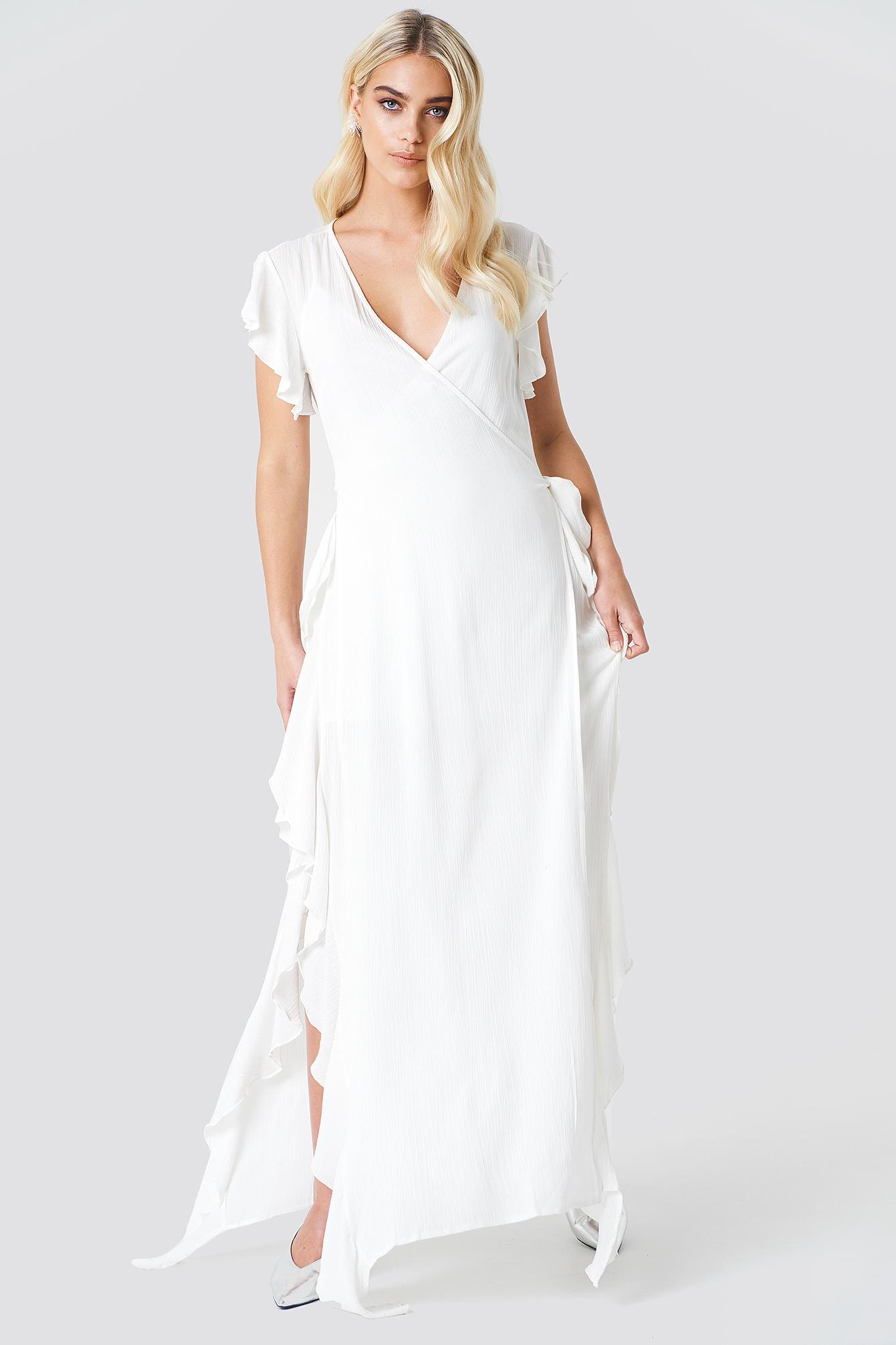 Prześwitująca sukienka kopertowa NA-KD.COM