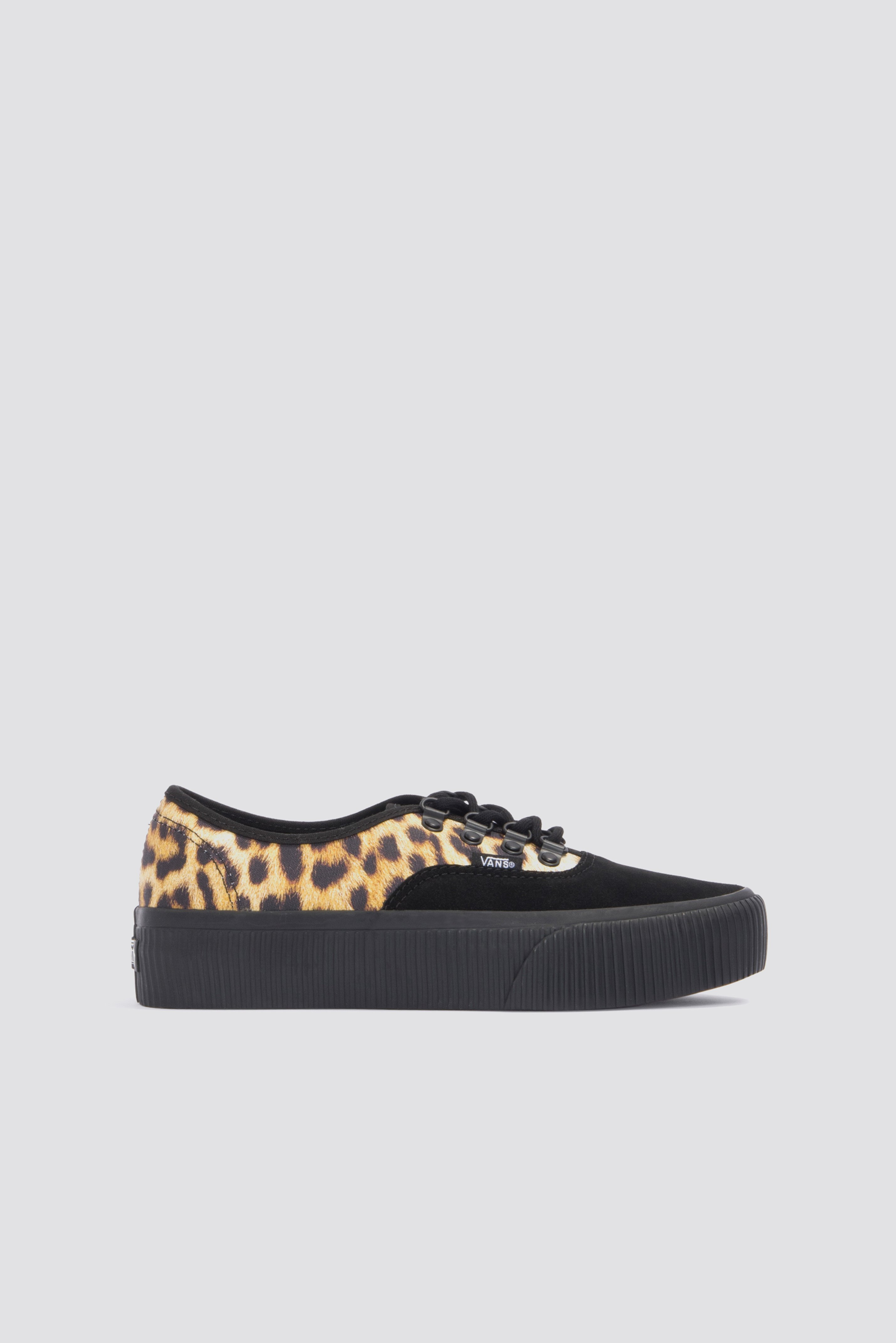 98436d4fa74e Vans  classic canvas shoe gets a bold punk update with a chunky creeper  sole and an animal-print upper tipped with rich suede at the toe for a  stylish