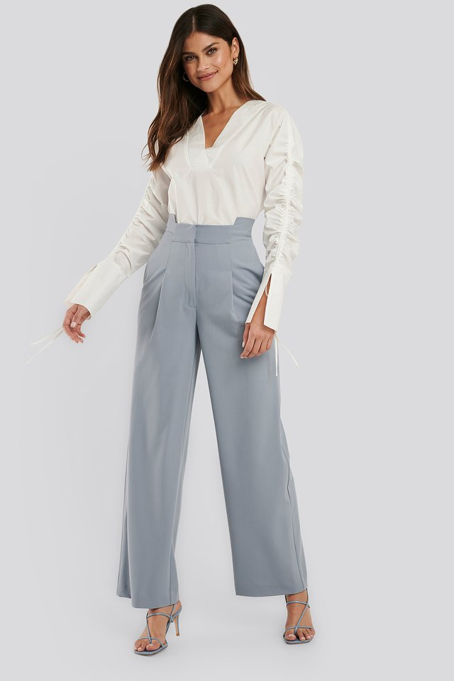 Light Blue Asymmetric Waist Pants