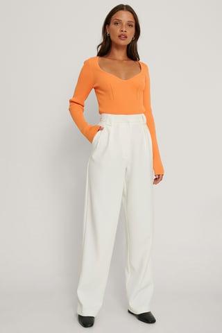 Orange Strickpullover Mit Brustdetail