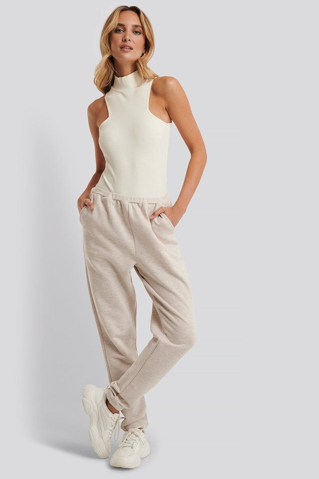 Elastic Waist Melange Sweatpants Beige Melange. Best joggers and the most stylish loungewear separates at the moment to wear loungewear outside. Easy to execute and effortlessly chic.