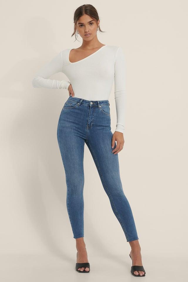 Mid Blue Organisch Skinny Jeans Met Hoge Taille En Ruwe Zoom