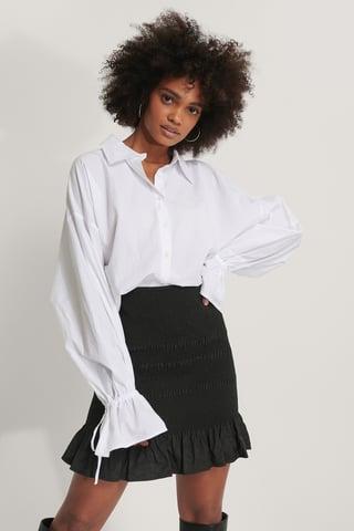Black Smocked Mini Skirt