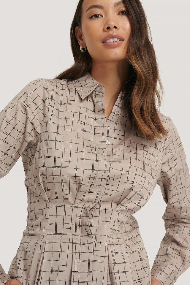 Check Skjorta Med Instoppad Midja