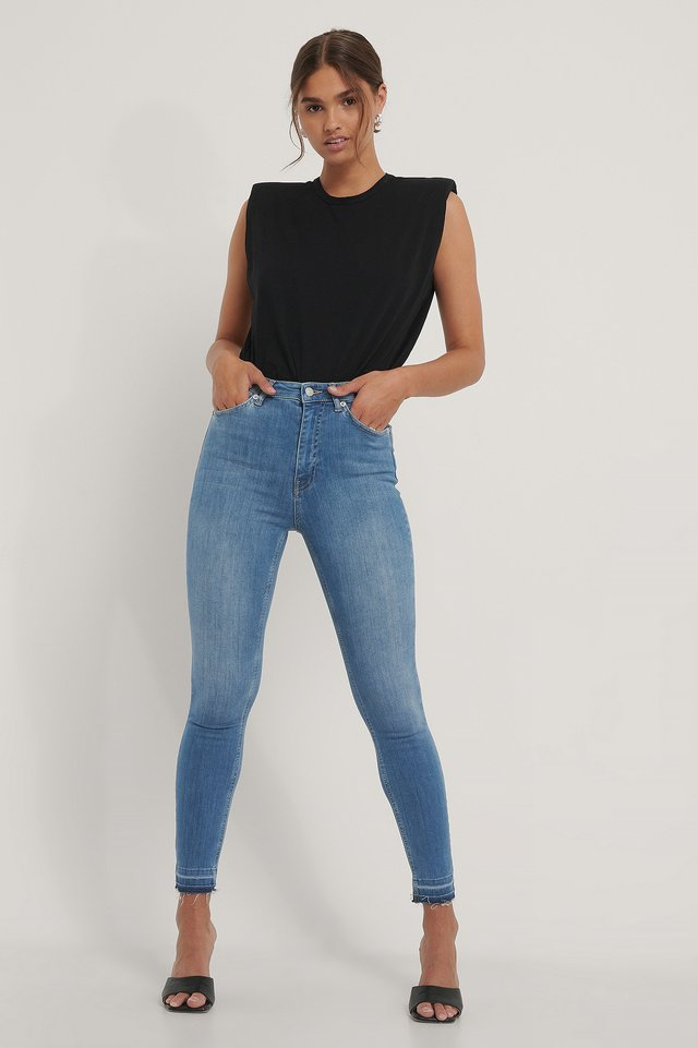 Organic Skinny High Waist Open Hem Jeans with Black Top.