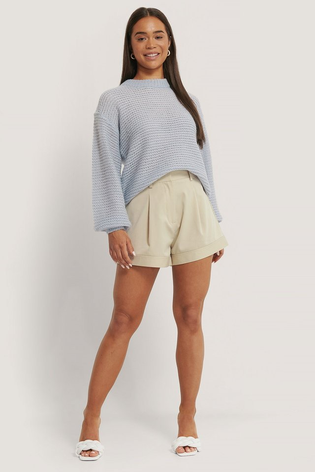 Style this knitted sweater with wide shorts, mules and hoops for a simple look!