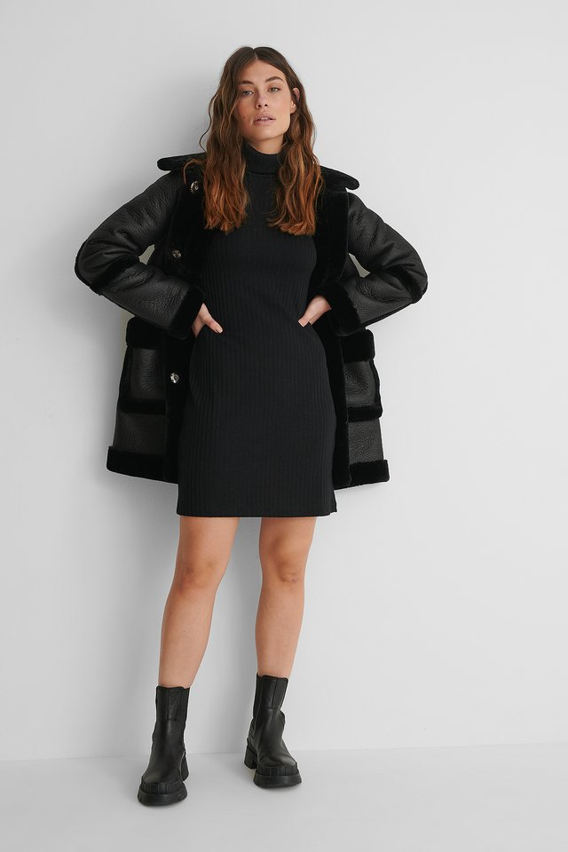 High Neck Rib Dress with Fake Fur Jacket and Boots.