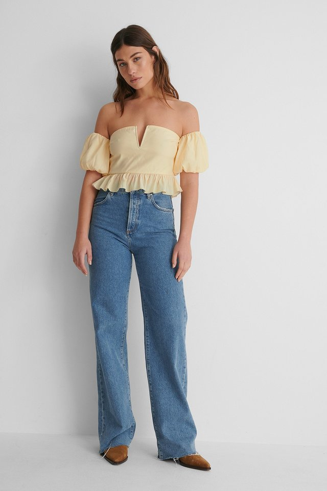 Off Shoulder Puff Short Sleeve Top with Blue Denim and Boots.