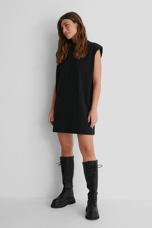 Shoulder Pad Mini Dress with Lace Shaft Boots.