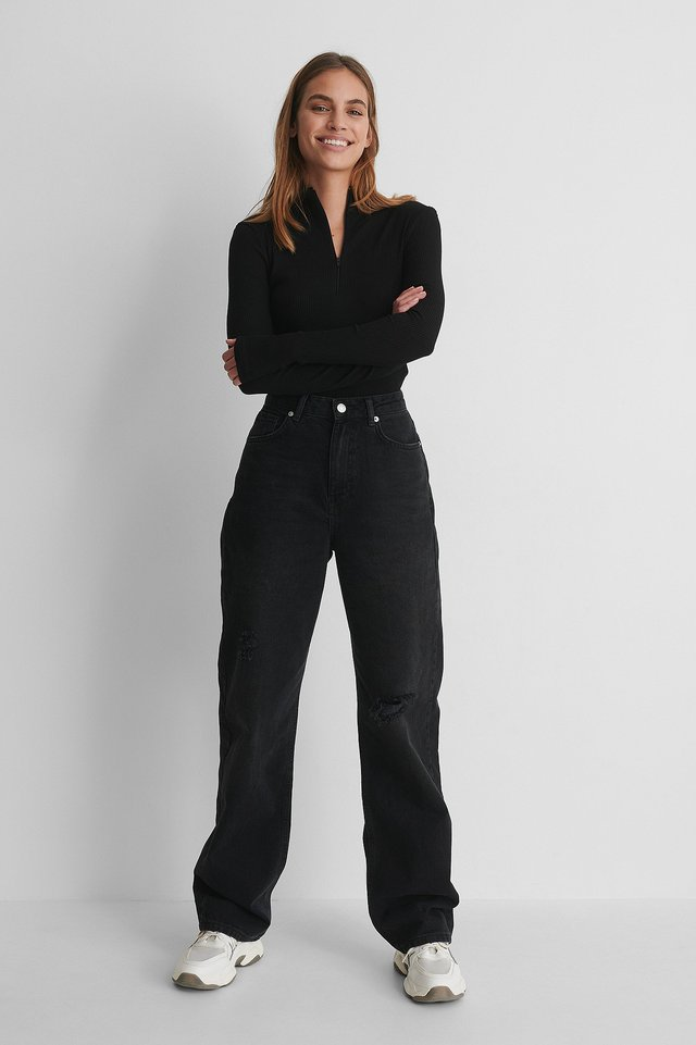 Zip Detail Top with Wide Leg Destroyed Detail High Waist Jeans and Sneakers.