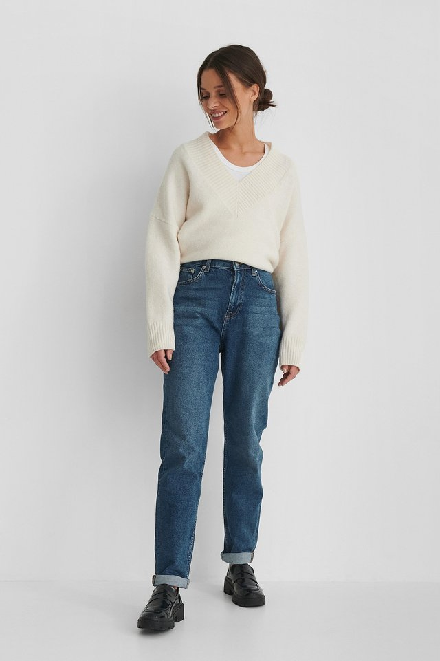 Organic Turn Up Mom Jeans with a White Knitted Sweater.