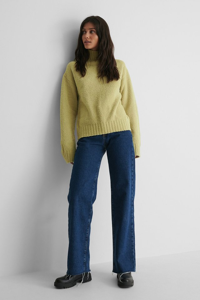High Neck Knitted Sweater with Wide Jeans and Boots.