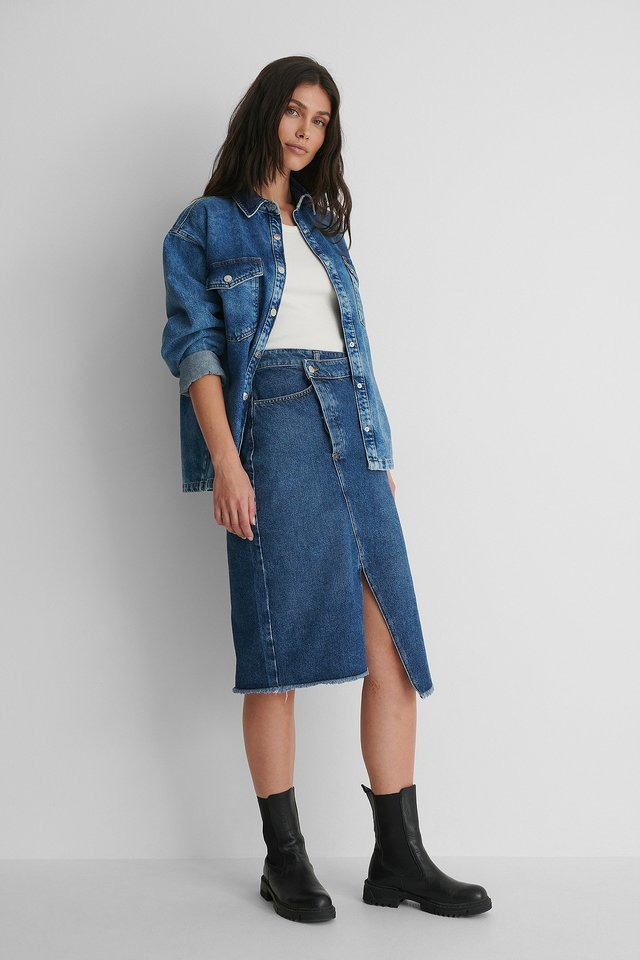 Asymmetric Denim Skirt with Denim Shirt and Boots.