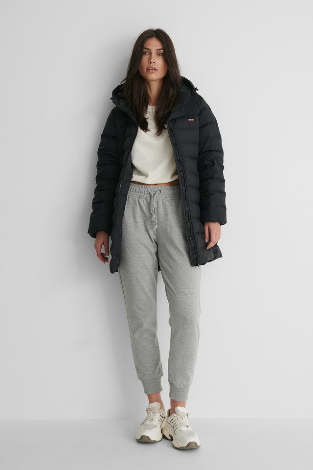 Core Down Mid Puffer Parka with Sweatpants and Sneakers.