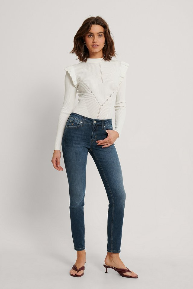 Mid Rise Skinny Jeans.