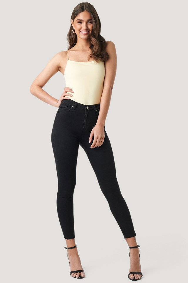 Skinny High Waist Raw Hem Jeans.