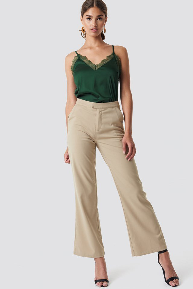 Green Singlet Paired With Wide Legged Trousers Party Outfit