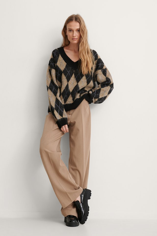 Jacquard Knit V-neck Sweater.