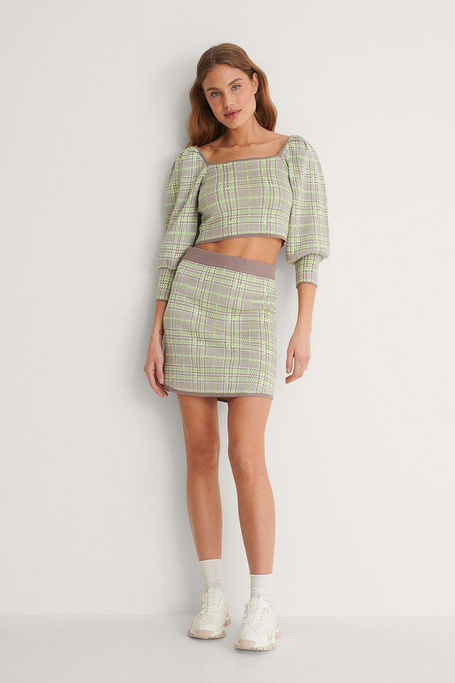 Style this checked knitted mini skirt with a knitted sweater and a pair of sneakers.