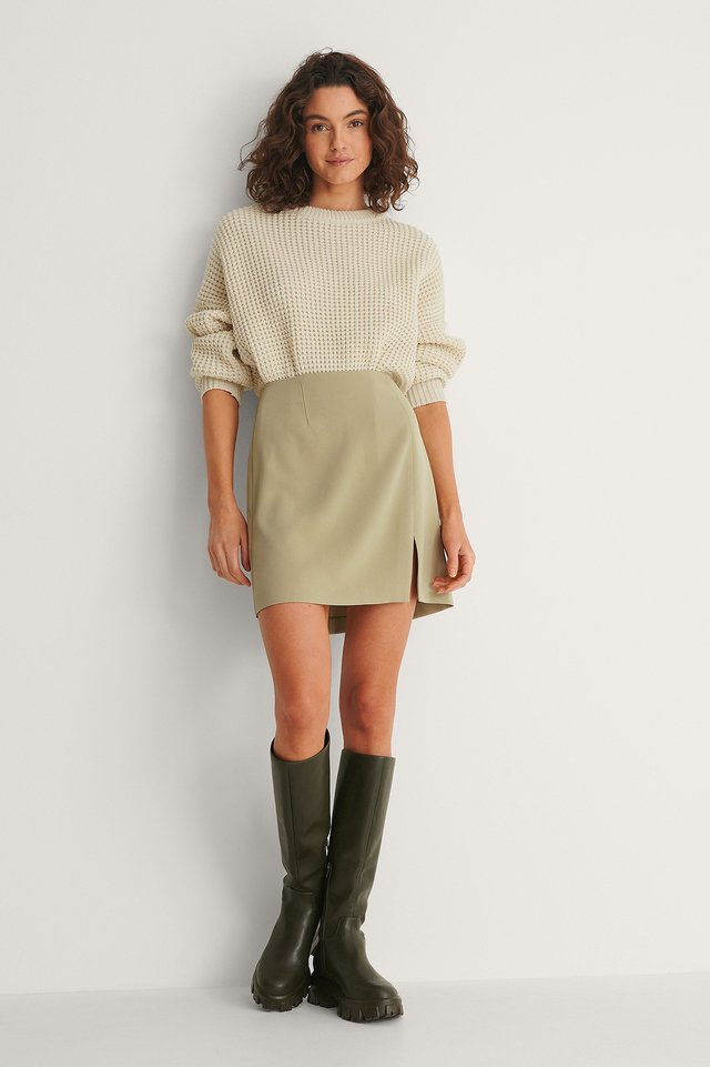 Style this mini skirt with a sweater and boots for a trendy and nice outfit. You will look so good in this!