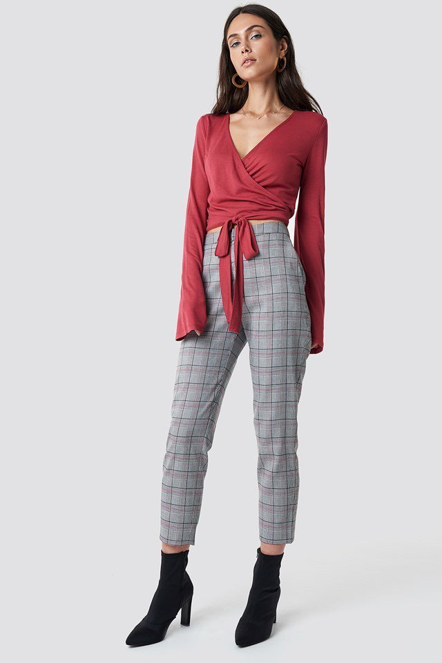 Red Top with Checked Pants.