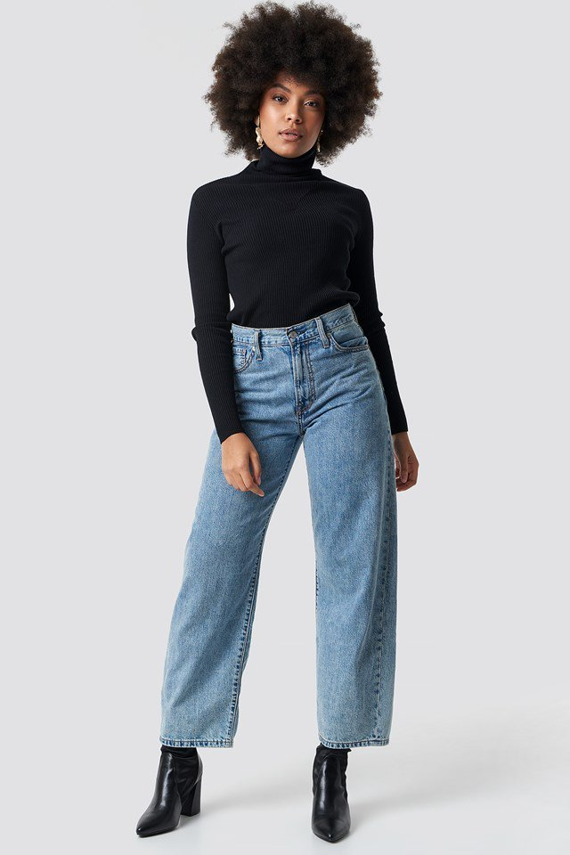 Detailed Knitted Polo Top with Wide Jeans and Black Boots.