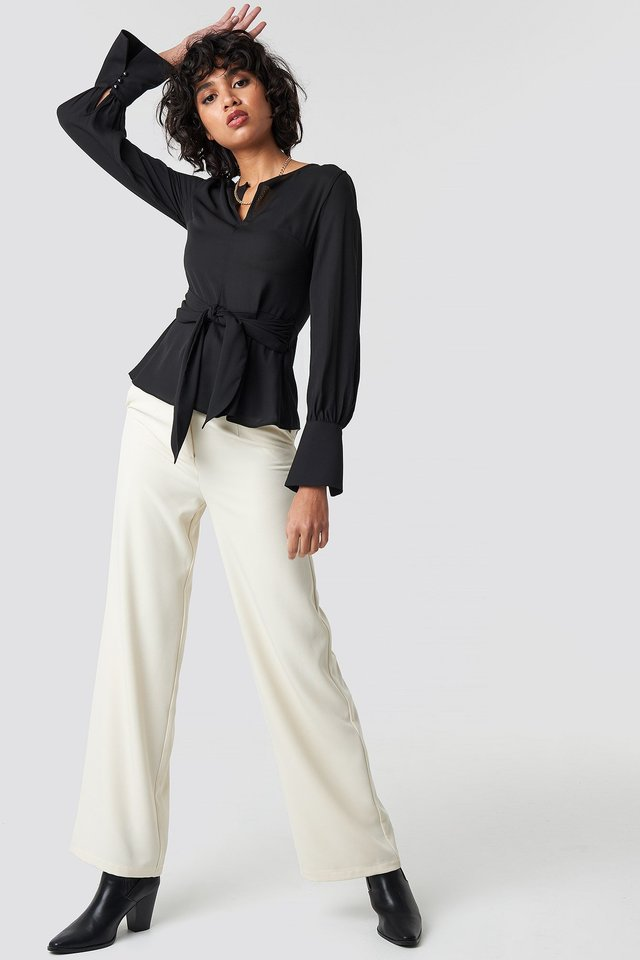 Style this blouse with a pair of pants, heeled boots and a necklace.