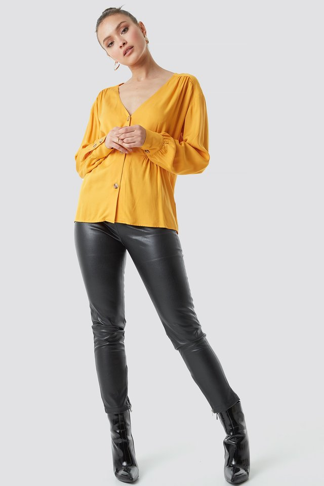 V-cut blouse outfit.