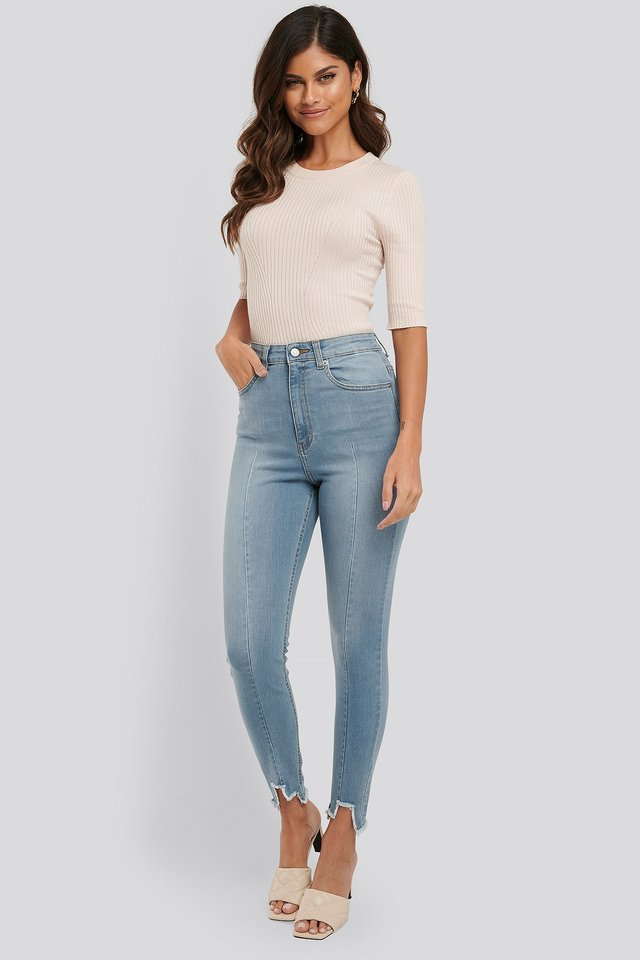 Super High Waist Asymmetrical Hem Jeans