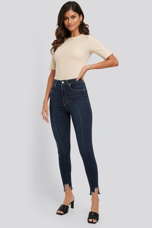Super High Waist Asymmetrical Hem Jeans
